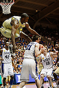 Duke forward Miles Plumlee is fouled hard by Georgia Tech's Gani Lawal in the second half. Duke University defeated Georgia Tech 86 to 67 in Durham, N.C., Thurs., Feb. 4, 2010.