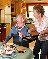 John Paul and Kathleen O'Connor tick into their Sasta Sausages and Black & White pudding at home in Cromane Co. Kerry..Photo:Don MacMonagle