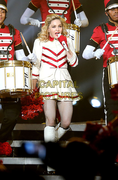 Madonna (Madonna Louise Ciccone) .Madonna performs at The Grand Garden Arena inside the MGM Grand Hotel and Casino, Las Vegas, Nevada, USA, .13th October 2012..music concert gig show live on stage performing half length red white cheerleader outfit costume knee high  boots collar gloves pompoms singing .CAP/ADM/MJT.© MJT/AdMedia/Capital Pictures.