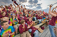 Fans cheer at the 102nd Annual Midnight Sun baseball game. Fairbanks Goldpanners, semi professional baseball team plays celebratory game on June 21st, the summer solstice, longest day of the year in Fairbanks, Alaska.