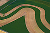 Aerial views of lines and textures in the earth. <br /> Farms and waterways, abstract and conceptual.