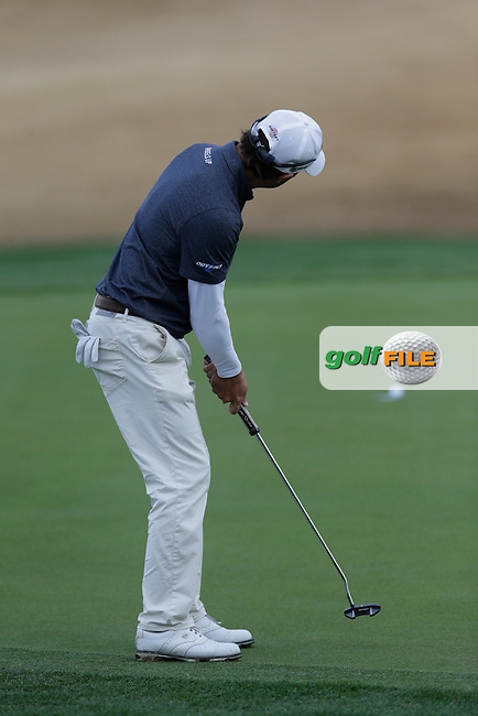 Kevin Kisner (USA) sinks his birdie putt on the 17th green during Thursday's Round 1 of the 2017 CareerBuilder Challenge held at PGA West, La Quinta, Palm Springs, California, USA.<br /> 19th January 2017.<br /> Picture: Eoin Clarke | Golffile<br /> <br /> <br /> All photos usage must carry mandatory copyright credit (&copy; Golffile | Eoin Clarke)