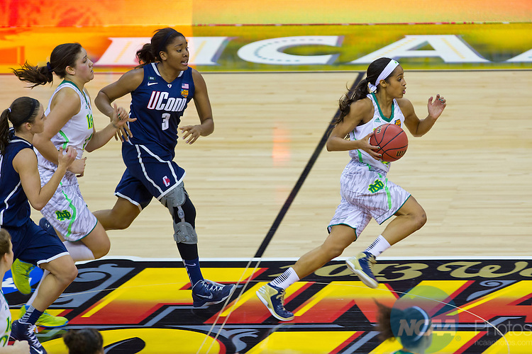 07 APR 2013:  Skylar Diggins (4) of Notre Dame makes a fast break down court with UCONN in hot pursuit at the national semi-final game between the University of Connecticut Huskies and the University of Notre Dame Fighting Irish at the Division I Women's Basketball Championship in New Orleans, LA.  UCONN defeated Notre Dame 83-65 to advance to the final. Matt Marriott/NCAA Photos