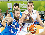 """Luigi Datome of Italt (L) and Nemanja Bjelica of Serbia in action during European basketball championship """"Eurobasket 2013""""  basketball game for 7th place between Serbia and Italy in Stozice Arena in Ljubljana, Slovenia, on September 21. 2013. (credit: Pedja Milosavljevic  / thepedja@gmail.com / +381641260959)"""
