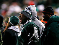 Former Michigan State basketball player Mateen Cleeves laughs on the sideline during Ohio State's 49-37 win over Michigan State in the NCAA football game at Spartan Stadium in East Lansing, Michigan on Nov. 8, 2014. (Adam Cairns / The Columbus Dispatch)