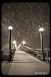 Pedestrian Bridge at Deeds Point on snowy winter night