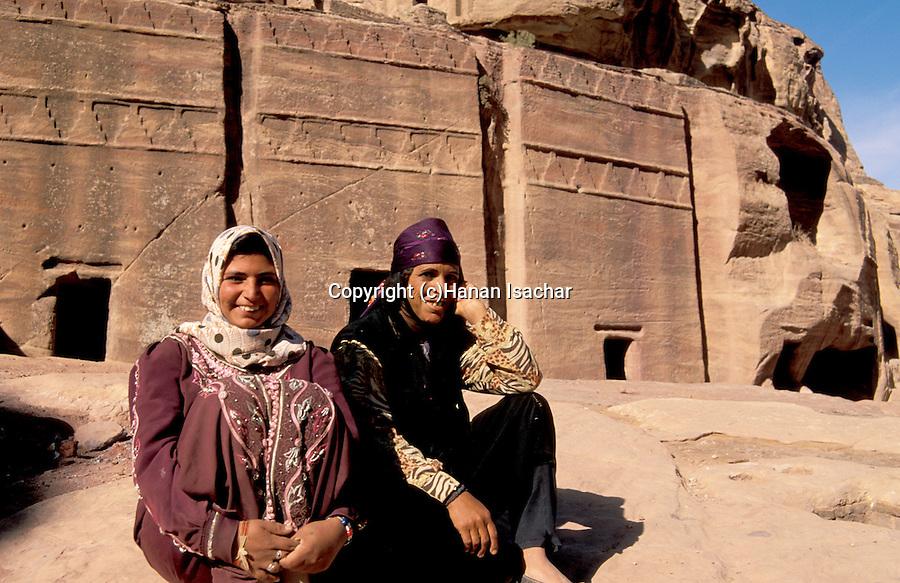 Jordan, Petra. Bedouin women in front of Nabatean tombs&#xA;<br />