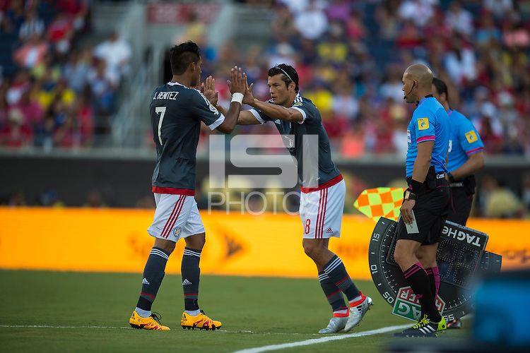 Orlando, Florida - Saturday, June 04, 2016: Paraguayan defender Jorge Benitez (7) is substituted for Paraguayan forward Nelson Valdez (18) during a Group A Copa America Centenario match between Costa Rica and Paraguay at Camping World Stadium.