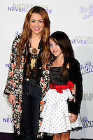 """LOS ANGELES - FEB 8:  Miley Cyrus & Guest arrives at the """"Never Say Never"""" Premiere at Nokia Theater  on February 8, 2011 in Los Angeles, CA"""