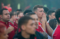 Wales fans feel the tension at the Cardiff Fanzone during the Euro 2016 quarter final between Wales and Belgium , Cardiff, Wales on 1 July 2016. Photo by Mark  Hawkins/PRiME Media Images.