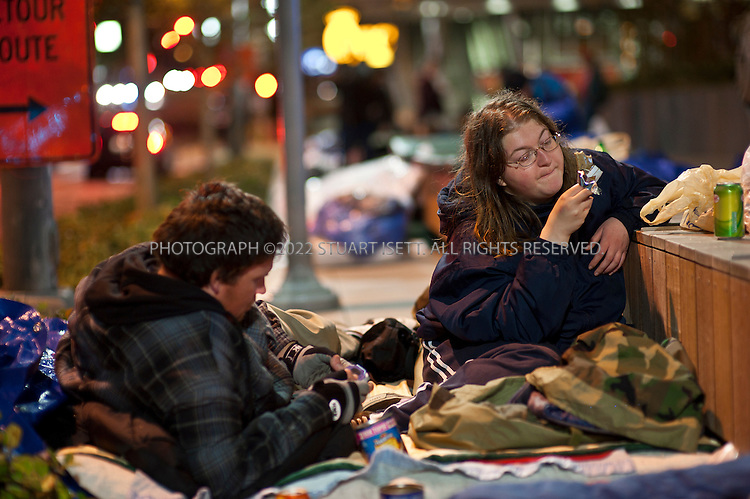 10/12/2011--Seattle, WA, USA..Homeless in Seattle, organized by SHARE (Seattle Housing and Resource Effort), camp outside the Bill and Melinda Gates Foundation in Seattle, WASH. SHARE runs 15 shelters in Seattle and says cuts in government funding have forced it to close the shelters and put 300 people onto the street. The 'sleepout' at the Gates Foundation started on Monday, Oct. 10th, with about 50 homeless camping out with blankets and tarps; SHARE organizers have asked the Gates Foundation for funds to support its local efforts to fight homelessness and reopen the closed shelters...HERE: Katie Bradbury, 25 (right) Michigan and her fiancé Stephen Felder, 30, (left) both of whom have been homeless for a year...©2011 Stuart Isett. All rights reserved.