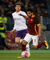 Calcio, Serie A: Roma vs Fiorentina. Roma, stadio Olimpico, 4 marzo 2016.<br /> Roma&rsquo;s Mohamed Salah, right, is chased by Fiorentina&rsquo;s Marcos Alonso during the Italian Serie A football match between Roma and Fiorentina at Rome's Olympic stadium, 4 March 2016.<br /> UPDATE IMAGES PRESS/Riccardo De Luca
