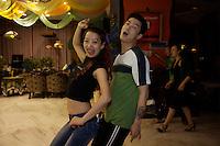 Chese emjoy Salsa dancing class.