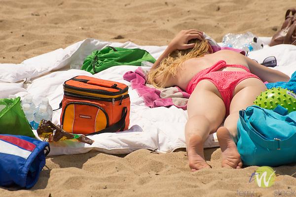 Hammonasset Beach State Park, New Haven County, Madison, Connecticut. Woman sunbathing  on beach