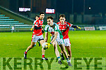 Jack Barry, Na Gaeil and St Pats Luke Mulligan in action  when the sides met in the St Bendans board final at Austin Stack Park Tralee last Friday night.