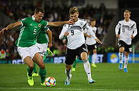 Ciaron Brown (Nordirland, Northern Ireland) klärt gegen Timo Werner (Deutschland Germany) - 09.09.2019: Nordirland vs. Deutschland, Windsor Park Belfast, EM-Qualifikation DISCLAIMER: DFB regulations prohibit any use of photographs as image sequences and/or quasi-video.