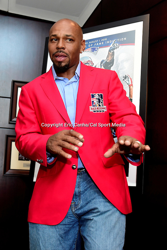 Friday, July 29, 2016: Former New England Patriots running back Kevin Faulk tries on his Patriots Hall of Fame jacket and speaks to the media at The Hall at Patriot Place in Foxborough Massachusetts prior to his induction on Monday, August 1, 2016. Eric Canha/CSM