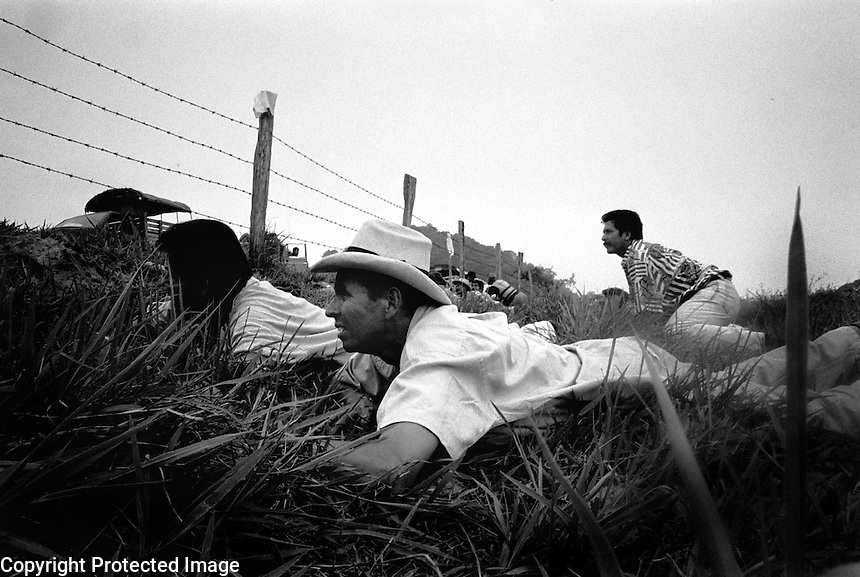 colombia1069 - civilians are caught in the crossfire between government troops and FARC guerrillas, near Puerto Rico, soon after 3 years of peace talks came to a sudden end. Caqueta march 2002<br />
