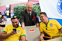 Moscow, Russia, 16/06/2018.<br /> A Vladimir Lenin lookalike with two Brazil supporters in central Moscow during the 2018 FIFA World Cup.