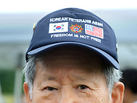 US Army veteran of the Korean War, Yang Chon Sin of Lansdale, Pennsylvania holds a photo of himself when he served during the war after the groundbreaking ceremony for the construction of the Korean War Memorial, America-Korean Alliance Peace Park Tuesday, August 8, 2017 at Memorial Grove Park in North Wales, Pennsylvania. (WILLIAM THOMAS CAIN / For The Philadelphia Inquirer)