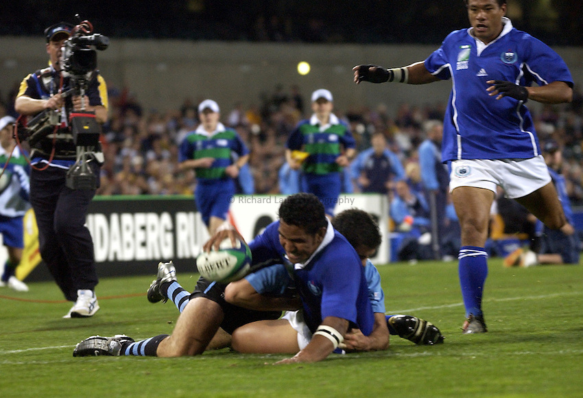 Photo: Richard Lane..Samoa v Uruguay, Pool C at the Subiaco Oval, Perth. RWC 2003. 15/10/2003. .Maurie Fa'asavalu touches down for a try.