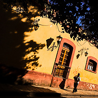 A Mexican Maya man walks on the colonial street during a sunny morning of San Cristóbal de las Casas, Chiapas, Mexico, 20 November 2018.