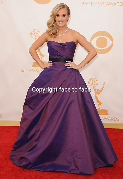 Carrie Underwood arrives at the 65th Primetime Emmy Awards at Nokia Theatre on Sunday Sept. 22, 2013, in Los Angeles.<br /> Credit: MediaPunch/face to face<br /> - Germany, Austria, Switzerland, Eastern Europe, Australia, UK, USA, Taiwan, Singapore, China, Malaysia, Thailand, Sweden, Estonia, Latvia and Lithuania rights only -
