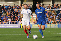 Rod McDonald of AFC Wimbledon in action as Portsmouth's Brett Pitman looks on during AFC Wimbledon vs Portsmouth, Sky Bet EFL League 1 Football at the Cherry Red Records Stadium on 13th October 2018