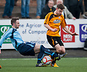 Alloa's Mitchel Megginson is challenged by Forfar's Michael Bolochoweckyj.