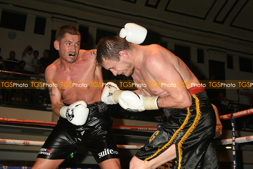 Tony Conquest (black shorts) defeats Jiri Svanica - Boxing at York Hall, Bethnal Green, London - 11/06/15 - MANDATORY CREDIT: Philip Sharkey/TGSPHOTO - Self billing applies where appropriate - contact@tgsphoto.co.uk - NO UNPAID USE