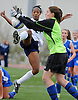 New Hyde Park, NY - November 11, 2009: South Side High School senior No. 21 Crystal Dunn, left, and Division Avenue goalie Brianna Spitaliere narrowly avoid a collision during the Nassau County varsity girls' soccer Class A final vs. at Tully Park. After becoming a four-time All-American at the University of North Carolina and winning the Hermann Award in 2013, Dunn was selected first overall by the Washington Spirit in the 2014 National Women's Soccer League College Draft. (Photo by James Escher)