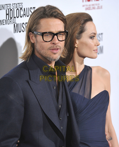 Brad Pitt and Angelina Jolie.'In The Land Of Blood And Honey' Los Angeles Premiere held at The Arclight Theatre, Hollywood, California, USA..8th December 2011.half length dress black navy blue one shoulder suit beard facial hair glasses profile couple.CAP/RKE/DVS.©DVS/RockinExposures/Capital Pictures.