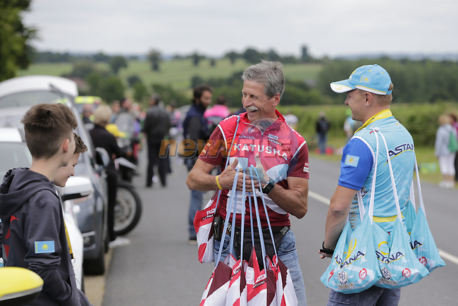 Katusha and Astana team soigneurs wait for their riders pass through the feed zone at La Hargriniere during Stage 3 of the 2016 Tour de France, running 223.5km from Granville to Angers, France . 4th July 2016.<br /> Picture: Eoin Clarke | Newsfile<br /> <br /> <br /> All photos usage must carry mandatory copyright credit (&copy; Newsfile | Eoin Clarke)