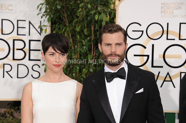 WWW.ACEPIXS.COM<br /> <br /> January 11 2015, LA<br /> <br /> Actress Amelia Warner (L) and actor Jamie Dornan arriving at the 72nd Annual Golden Globe Awards at The Beverly Hilton Hotel on January 11, 2015 in Beverly Hills, California.<br /> <br /> <br /> By Line: Peter West/ACE Pictures<br /> <br /> <br /> ACE Pictures, Inc.<br /> tel: 646 769 0430<br /> Email: info@acepixs.com<br /> www.acepixs.com