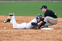 February 18, 2012: Long Island second baseman Brad Greve (3) is unable to handle the ball as UCF outfielder Alex Friedrich (39) dives back to 2nd base during game 2 of non conference NCAA baseball game action between the LIU Brooklyn Blackbirds and the Central Florida Knights. UCF defeated Long Island in game 2 9-1 at Jay Bergman Field in Orlando, FL