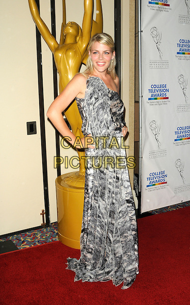 BUSY PHILLIPS.arriving at the Academy of Television Arts and Sciences Foundation's 31st Annual College Television Awards honoring the Nation's Best in Student Film, Video and Digital Works at the renaissance Hotel in Hollywood, California, USA,  April 10th, 2010..full length long maxi dress one shoulder smiling grey gray black and white print hands on hips .CAP/ROT.©Lee Roth/Capital Pictures