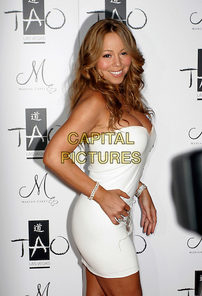MARIAH CAREY.Mariah Carey Hosts New Year's Eve at TAO Nightclub at The Venetian Hotel Casino,  Las Vegas, Nevada, USA, 31 December 2007..half length strapless white mini dress  cleavage hand on hip side.CAP/ADM/MJT.©AdMedia/Capital Pictures.