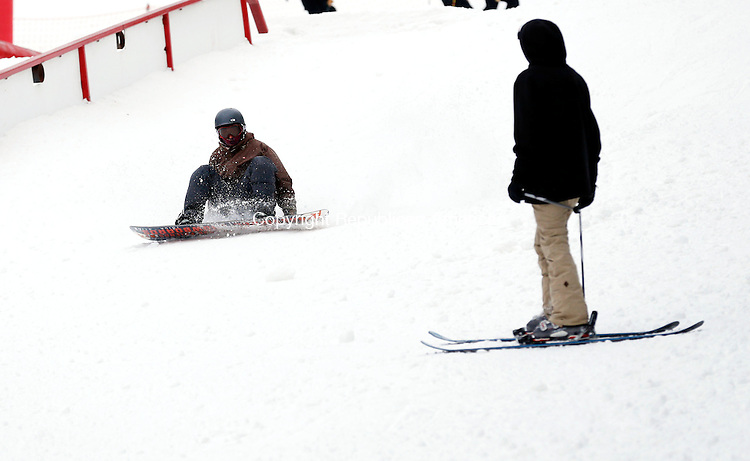 New Hartford, CT- 08 January 2016-010816CM01-  John Palacios of Granby snowboards at Ski Sundown in New Hartford on Friday.  With the colder temperatures, ski resorts have been able to make snow for winter enthusiasts allowing them to participate in skiing and snowboarding.    Christopher Massa Republican-American
