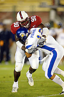 Louis Hobson makes a sack during Stanford's 63-26 win over San Jose State on September 14, 2002 at the Stanford Stadium in Stanford, CA.<br />Photo credit mandatory: Gonzalesphoto.com