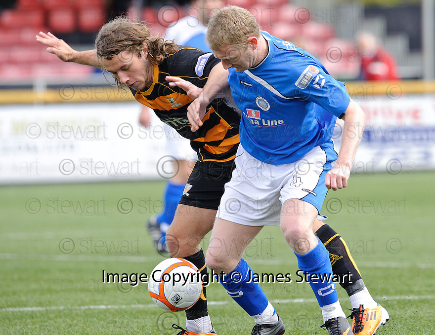 Alloa's Stevie May and Stranraer's John Kane challenge for the ball.