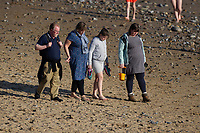 WEATHER PICTURE WALES<br /> A family take a stroll on the beach during the unusually warm weather in Langland Bay near Swansea, Wales, UK. Wednesday 27 February 2019
