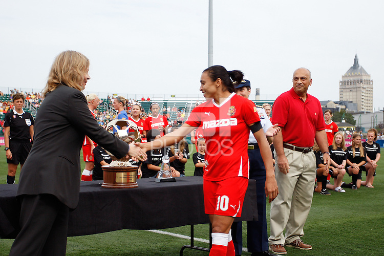 WPS CEO Anne-Marie Eileraas  honors Marta (10) of the Western New York Flash with the PUMA Golden Boot award. The Western New York Flash defeated the Philadelphia Independence 5-4 in a penalty kick shootout after playing to a 1-1 tie during the Women's Professional Soccer (WPS) Championship presented by Citi at Sahlen's Stadium in Rochester NY, on August 27, 2011.