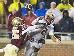 Florida State defenders P.J. Williams, left, and Lamarcus Brutus break up a pass back to Boston College quarterback Tyler Murphy, right, in the endzone in the second half of an NCAA college football game in Tallahassee, Fla., Saturday, Nov. 22, 2014.  Florida State defeated Boston College 20-17.  (AP Photo/Mark Wallheiser)