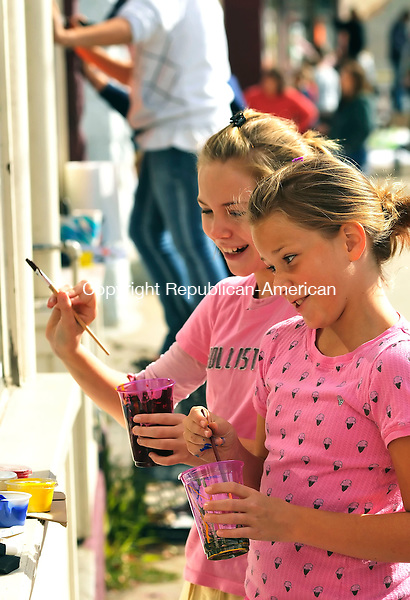 WINSTED, CT-17 OCTOBER 2009-101709JS03- Olivia Goldberger, 11, and Jordan Johnson, 11, both from Winsted, paint a storefront window during a Halloween window painting contest in Winsted on Saturday. The event is sponsored by The Friends of Main Street.  <br /> Jim Shannon Republican-American