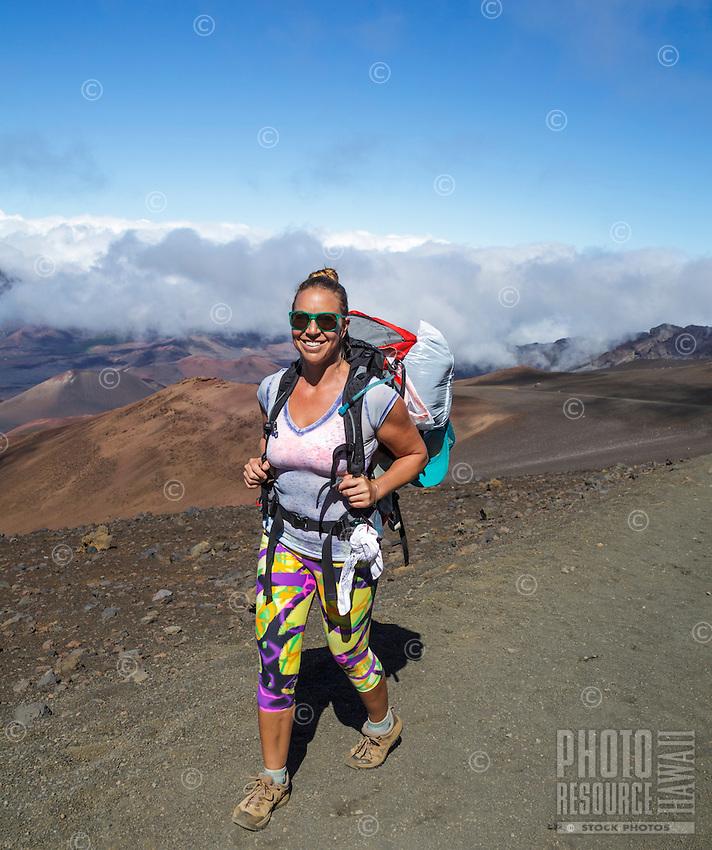 A backpacker follows the Sliding Sands Trail at Haleakala National Park, Maui.