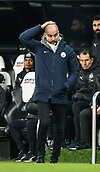 29th January 2019, St James Park, Newcastle upon Tyne, England; EPL Premier League football, Newcastle United versus Manchester City; Manchester City manager Pep Guardiola rubs his head in frustration near the end of the game