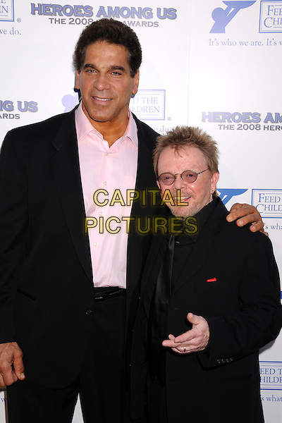 "LOU FERRIGNO & PAUL WILLIAMS .The 2008 Hero Awards ""Heroes Among Us"" at the Universal Hilton Hotel, Universal City, California, USA..June 6th, 2008.half length black suit jacket pink shirt tall short glasses .CAP/ADM/BP.©Byron Purvis/AdMedia/Capital Pictures."