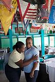 EXUMA, Bahamas. Waitresses at the Staniel Cay Yacht Club in Staniel Cay.