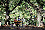 Visitors relax near the lake inside  Inokashira Park in  the trendy neighborhood of Kichijoji in Musashino City,  Tokyo, Japan on 16 Sept. 2012.  Photographer: Robert Gilhooly
