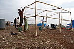 ARBAT, IRAQ: Syrian men erect a shelter in the Arbat refugee camp...45 families who have fled the violence in Syria are currently living in the Arbat refugee camp 19km outside the Iraqi city of Sulaimaniyah...Photo by Zmnako Ismael/Metrography